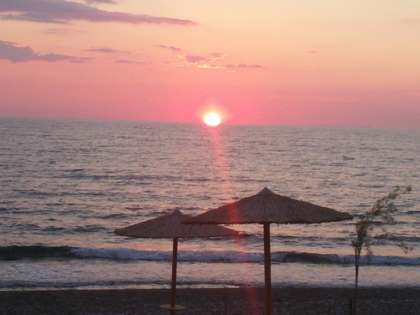 Sunset and beach at Irida Resort Suites